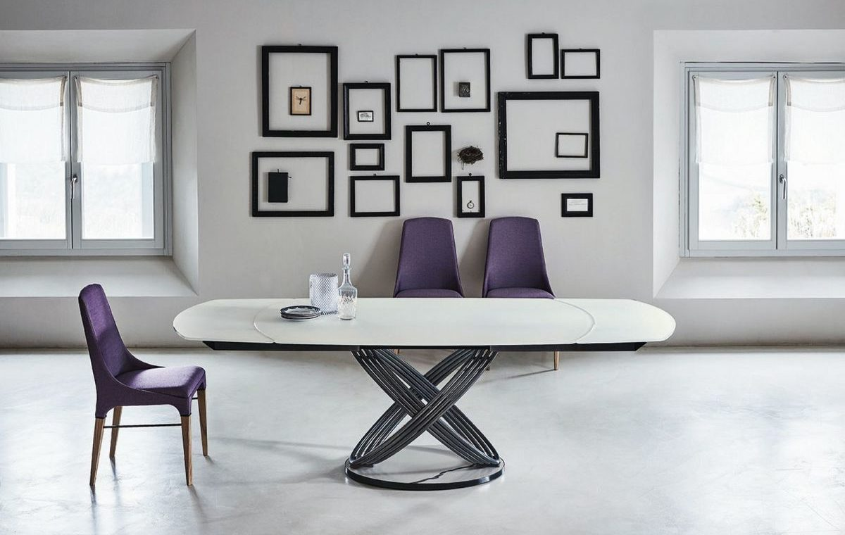Fusion Table with Chairs and frames in the background